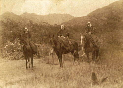 Sisters on horseback (sepia)