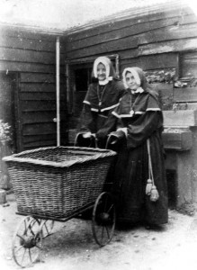 Sisters Baptista and de Sales with the begging pram